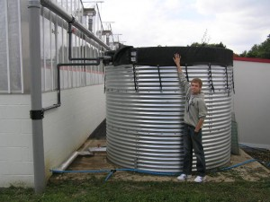 John checking the rain water storage tank